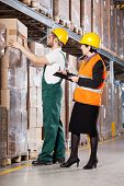 Superior And Worker In Warehouse