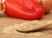 Raw Quinoa On A Wooden Spoon, Macro Selective Focus.