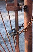 image of chain link fence  - Old rusty lock on a rusty chain link security fence - JPG