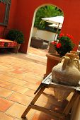 Courtyard of mediterranean villa in French Riviera. Shallow depths of filed, focus on amphoras.