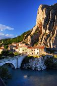Houses at the base of a cliff in town of Sisteron in Provence