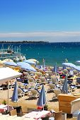 Beach along Croisette promenade in Cannes, France