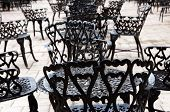 Wrought iron furniture on the outdoor cafe patio