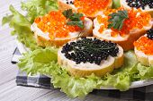 image of butter-lettuce  - Sandwiches with red and black fish caviar with lettuce closeup horizontal - JPG