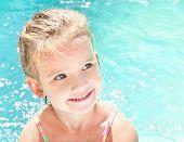 Pretty Little Girl In Swimming Pool