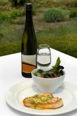 stock photo of swordfish  - Grilled Swordfish with Lemon and Chive Beurre Blanc Sauced served with a Mixed Leaf Spring Salad accommpanied by a glass of Cabernet Sauvignon Blanc - JPG