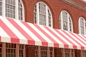 Brick Building With Striped Awning