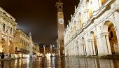 stock photo of palladium  - Night view of the marvellous Piazza dei Signori in vicenza in Italy with the wonderful Basilica PAlladiana work of architect Andrea Palladio and the Loggia del Capitaniato left - JPG