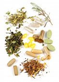 Herbs,  herbal supplements and vitamin pills on white background