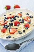 Bowl of hot oatmeal breakfast cereal with fresh berries