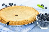 Whole baked blueberry pie with fresh  blueberries