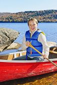 Teen girl canoeing on Lake of Two Rivers, Ontario, Canada