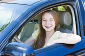 Teenage female driving student learning to drive a car