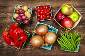 stock photo of root vegetables  - Fresh farmers market fruit and vegetable produce from above - JPG