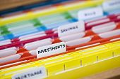 Open file folder drawer with many multicolored files containing personal finance documents