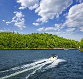Motorboat on summer lake in Georgian Bay, Ontario, Canada