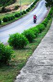 modern motor scooter on the asphalt road
