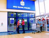 KRAKOW, POLAND, 25 OCTOBER 2003 -- A customer withdraws money from a Bank PKO BP automated teller ca