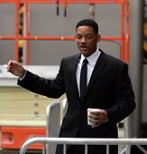 NEW YORK CITY - APRIL 15: Actor Will Smith starts singing to his coffee cup on the set of Men In Black 3 (MIB3) which is being filmed in New York, NY on April 15, 2011.