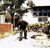 MOSTAR, BOSNIA - MAY 24: A Bosnian-Croatian soldier runs for cover during a pitched battle on Monday