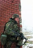 TUZLA, BOSNIA - JAN 26: United States Army troops, in Bosnia as part of NATO's IFOR,  protect a fron