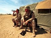 KUWAIT-IRAQ BORDER - FEBRUARY 22: Two United States Army soldiers enjoy a bit of a rest between mili