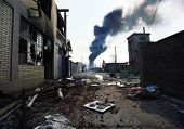 MITROVICA, KOSOVO - JUNE 16: A fire burns out of control in the destroyed city center of Mitrovica, Kosovo, on Wednesday, June 16, 1999. The fires were started by ethnic Albanians seeking revenge against their Serb neighbors.