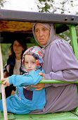 SUVA REKA, KOSOVO - OCTOBER 10: Kosovar refugees arrive by tractor to a makeshift camp near the bord