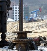 BAKU - AZERBAIJAN - FEB. 4: A drilling rig and a nodding donkey at a producing oil field near Baku,