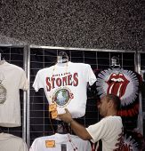 WASHINGTON, D.C. - AUG 4: A merchant prepares to sell tour T-shirts during the Rolling Stones' Steel Wheels Tour in Washington, D.C., on Thursday, August 4, 1994.