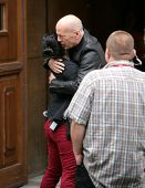 BUDAPEST - MAY 7: Actor Bruce Willis greets a production assistant on the first day of shooting of D