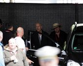 BUDAPEST - MAY 19: Actor Bruce Willis laughs it up with crew members on the set of Die Hard 5: A Goo