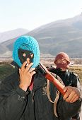 BALSH, ALBANIA, 15 MARCH 1997 - Albanian militiamen hold a piece of road linking Albania's south wit