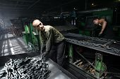 DONETSK - JULY 13: Steel workers create linked chain at the CJSC Vistec steelworks in Donetsk, Ukrai