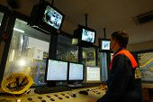 KOSICE - APRIL 25:  Workers in a computer controlled operation's center keep an eye on production at