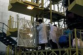 BAIKONUR COSMODROME - OCTOBER 29 2000:  Russian space technicians and engineers test the solar array