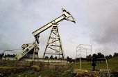 TBILISI - MAY 6:  Soviet-era oil derricks pump oil out of the ground at an oil field outside of Tbilisi, Georgia, on May 6, 2003. Mandatory Credit: Photo by M. Milstein/NorthFoto