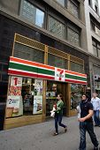NEW YORK CITY - APRIL 19: People walk past a 7-11 convenience store in New York City, on Friday, Apr