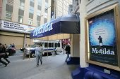 NEW YORK CITY - APRIL 19: People walk past the Shubert Theater featuring the Broadway play Matilda i