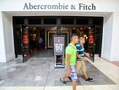PARAMUS - JULY 9: Shoppers walk past an Abercrombie & Fitch retail clothing store in Paramus, New Je