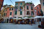 MONTEROSSO - ITALY: AUG 17: Pedestrians walk through a square of restaurants and bars along the coas