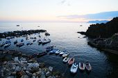 RIOMAGGIORE - ITALY: AUG 17: Boats in the marina in Riomaggiore, Italy, on Sunday, August 17, 2013. The village is one of five making up Cinque Terre.