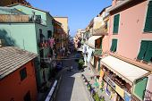 MANAROLA - ITALY: AUG 17: People walk on the main street of Manarola, Italy, on Sunday, August 17, 2