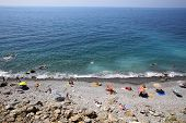 CORNIGLIA- ITALY: AUG 17: Bathers enjoy Guvano Beach, a known favorite among nudists, along the coast of Cinque Terre in Corniglia, Italy, on Sunday, August 17, 2013.