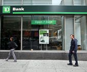NEW YORK CITY - OCT 23 2013:  Pedestrians walk past a branch office of TD Bank, N.A.,  in Manhattan