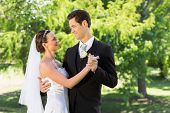 image of half-dressed  - Young bride and groom couple dancing on wedding day - JPG