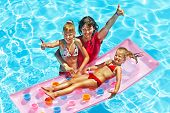 Family with children in swimming pool. Summer outdoor.