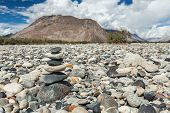 stock photo of jammu kashmir  - Zen balanced stones stack in Himalayas mountains - JPG