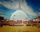 Vintage retro hipster style travel image of Mirisavatiya Dagoba (stupa) in Anuradhapura, Sri Lanka with grunge texture overlaid