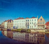 Vintage retro hipster style travel image of canal and medieval houses. Bruges (Brugge), Belgium with